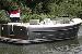 Afbeelding motorboot in gebruik voor vaarlessen